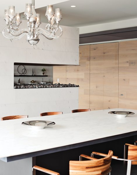 In a couple's Mexico City apartment designed by David Levy of Flexform, a Murano chandelier hangs above a marble-topped dining table from the showroom.