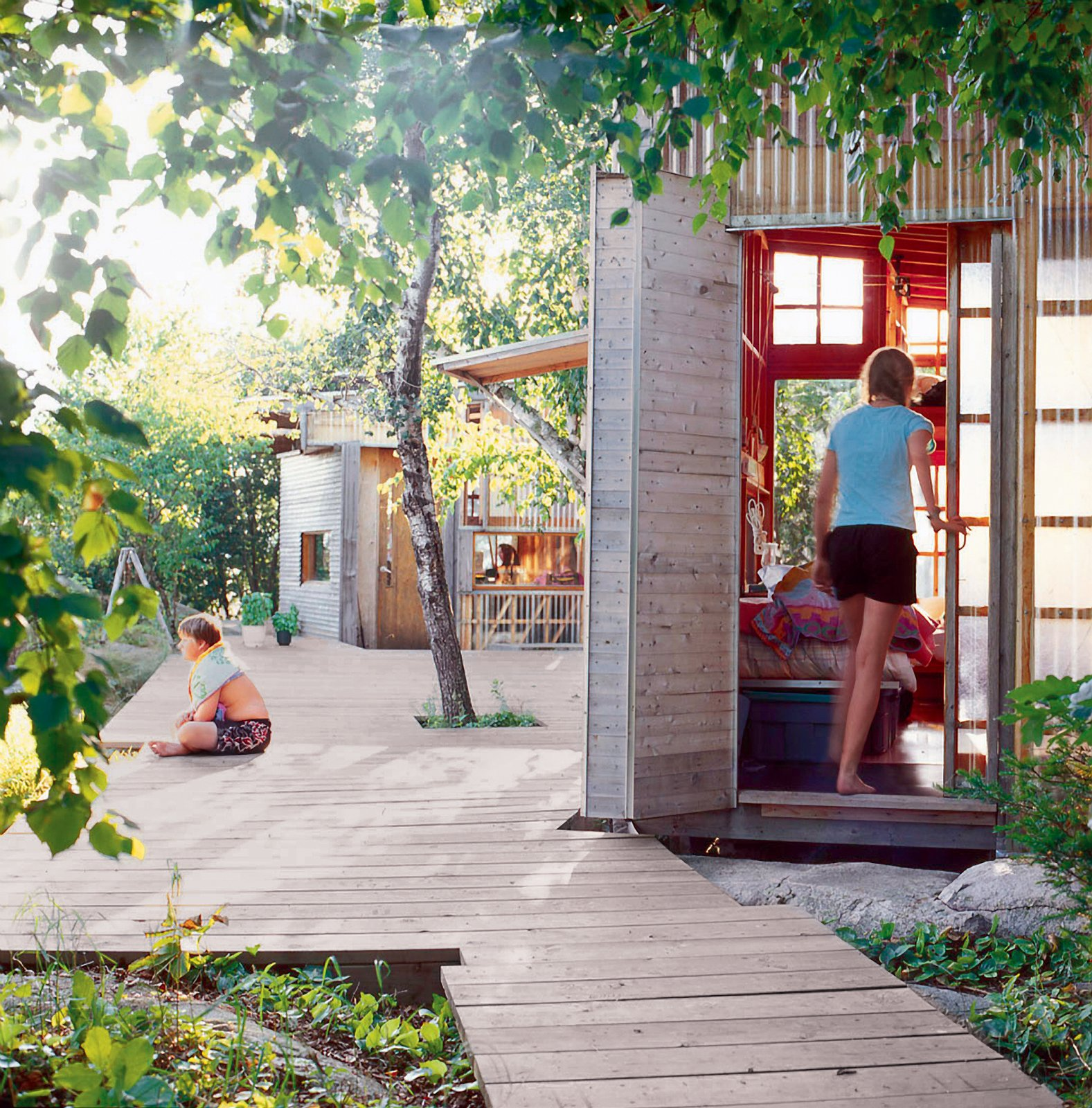 A series of reclaimed-wood-clad structures make a family compound on a 24-acre island on Shoal Lake. Tagged: Outdoor, Large Patio, Porch, Deck, Wood Patio, Porch, Deck, and Walkways.  Best Photos from Barely There