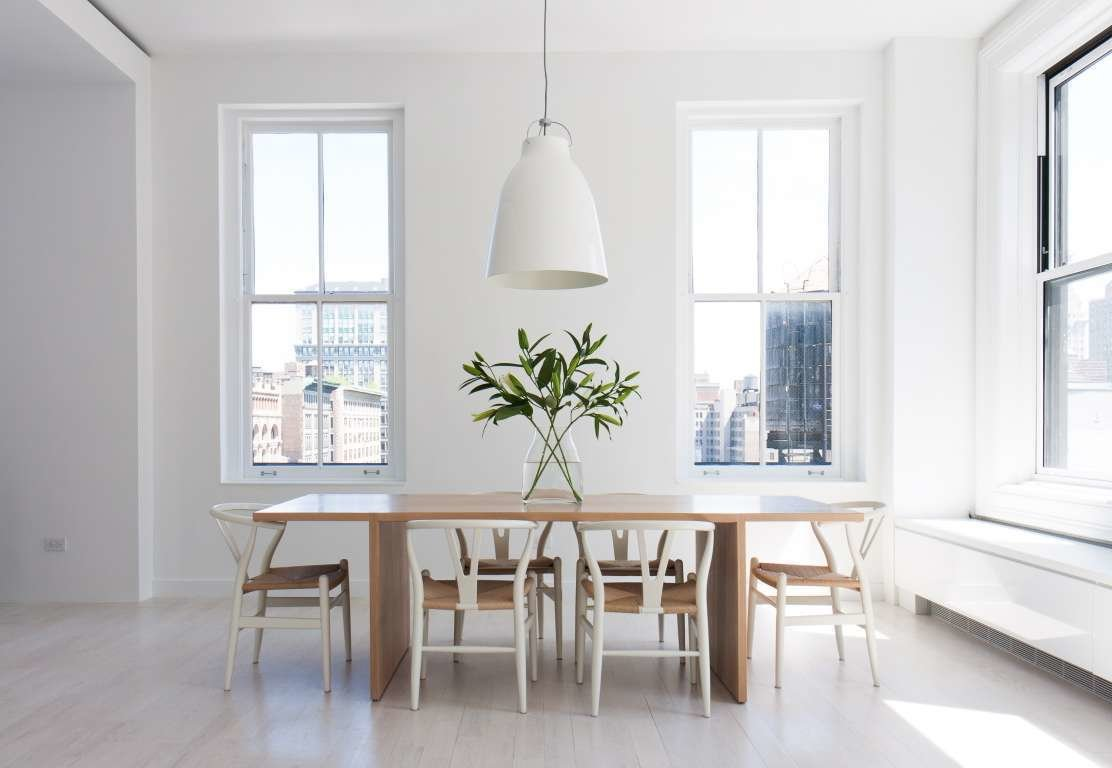 Resolution 4: Architecture designed a Union Square duplex for an expat couple with two children. Hans Wegner Wishbone chairs are arranged around a wooden dining table in one sunny corner of the apartment.  In the Home by Carl Hansen & Son from Call for Dwell New York Home Tour Submissions