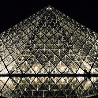The iconic glass pyramid addition to Musée du Louvre in Paris is one of the most recognizable structures in the world, and arguably Pei's most famous structure. However, when it was first proposed, Pei's plan was highly controversial. Created as part of a renovation for the world-famous museum that's housed in a grand French Renaissance-style former palace, the glass-and-steel pyramids in the center courtyard of the complex were designed to allow light into a new subterranean concourse.