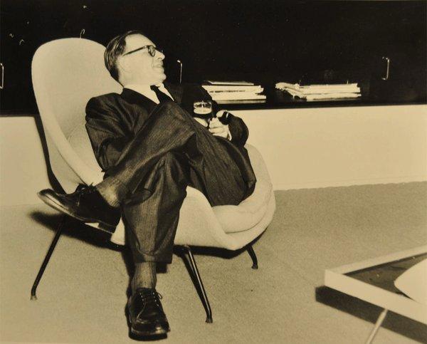 Eero Saarinen sitting in a Womb chair. Photo courtesy of Harvey Croze, Cranbrook.