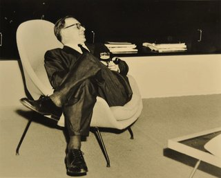 Eero Saarinen sitting in a Womb chair. Photo courtesy of Harvey Croze, Cranbrook.