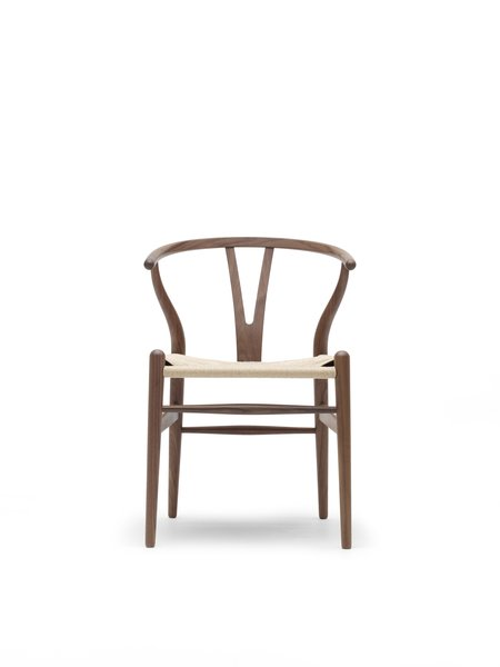 The Wishbone Chair (1949), also known as the Y Chair, marries a hand-woven seat and steam-bent frame. The chair, an undisputed modern icon, has been in continuous production since its introduction in 1950. Inspired by portraits of Danish merchants sitting in Ming chairs, this was the culmination of a series of chairs created in the '40s. Photo courtesy Carl Hansen & Son.