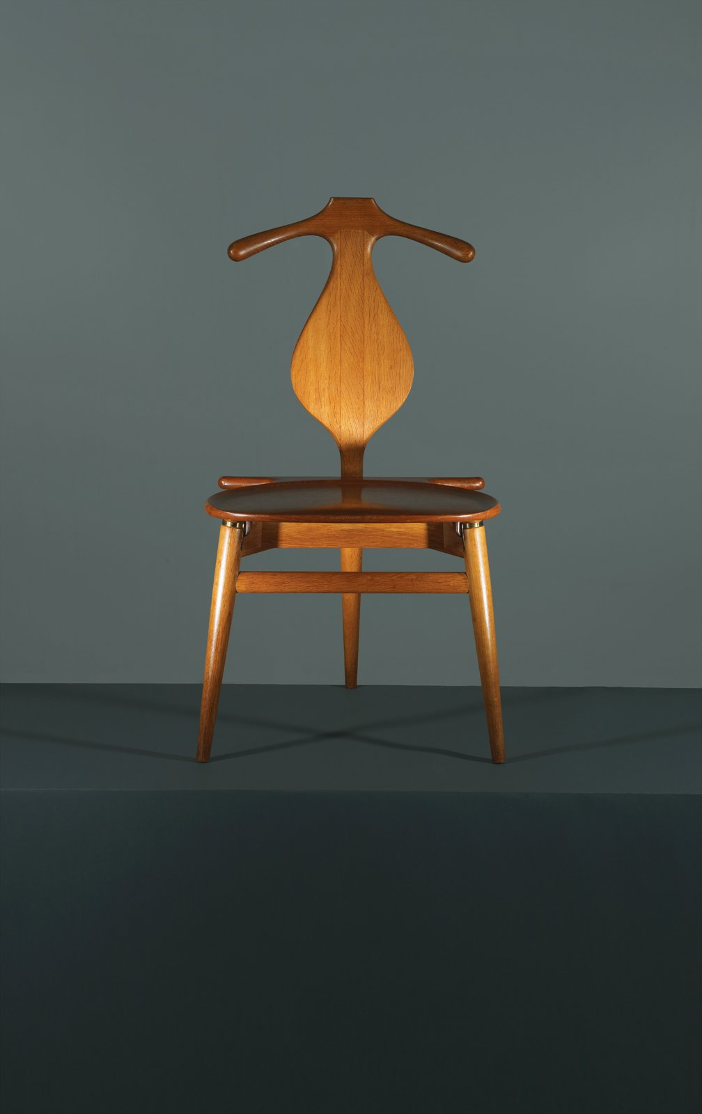 Combining the best traits of a bench and a butler, Hans Wegner's 1953 Valet chair is the one piece of midcentury-modern furniture that the fastidiously turned-out chap overlooks at his peril. Marrying formal elegance—these handsome curves have been handcrafted in PP Møbler's Danish workshop since it took over production in 1982—with a surprising functionalism, the Valet chair all but does away with the need for Jeeves. Initially a four-legged chair, Wegner decided to trim the final product and arrived at a tripod design, though he maintained the initial design when Danish King Frederick IX requested his own. Manufactured by PP Møbler.
