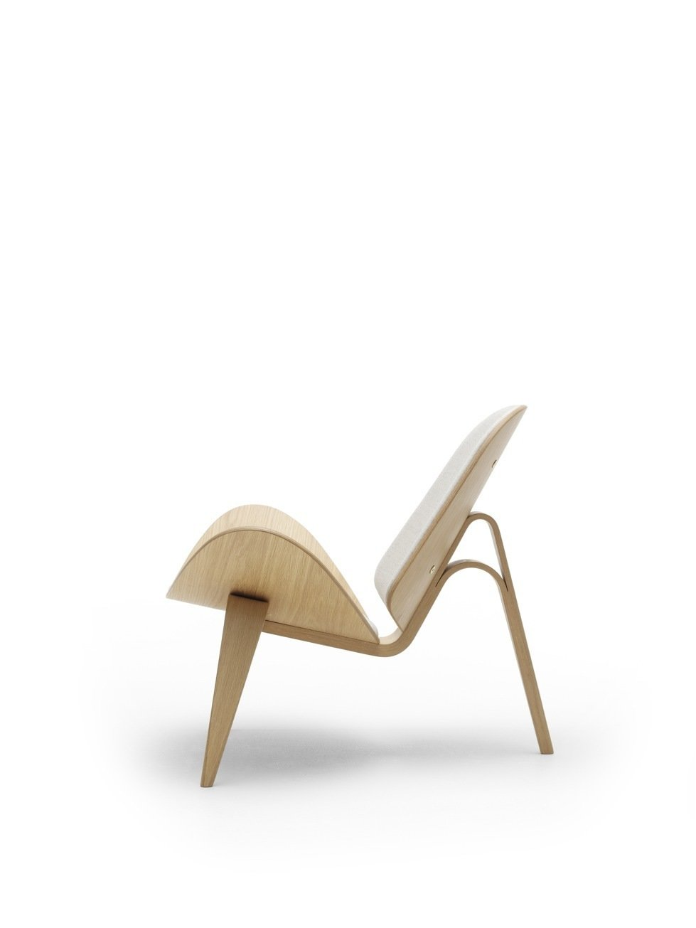 The public was initially reluctant to accept the Three-Legged Shell Chair (1963), an edgier piece of work, from Wegner, which debuted at the 1963  Furniture Guild Exhibition in Copenhagen, but has become more attracted to the wavy, airy design since the chair was reintroduced in 1998. Photo courtesy of Carl Hansen & Son.