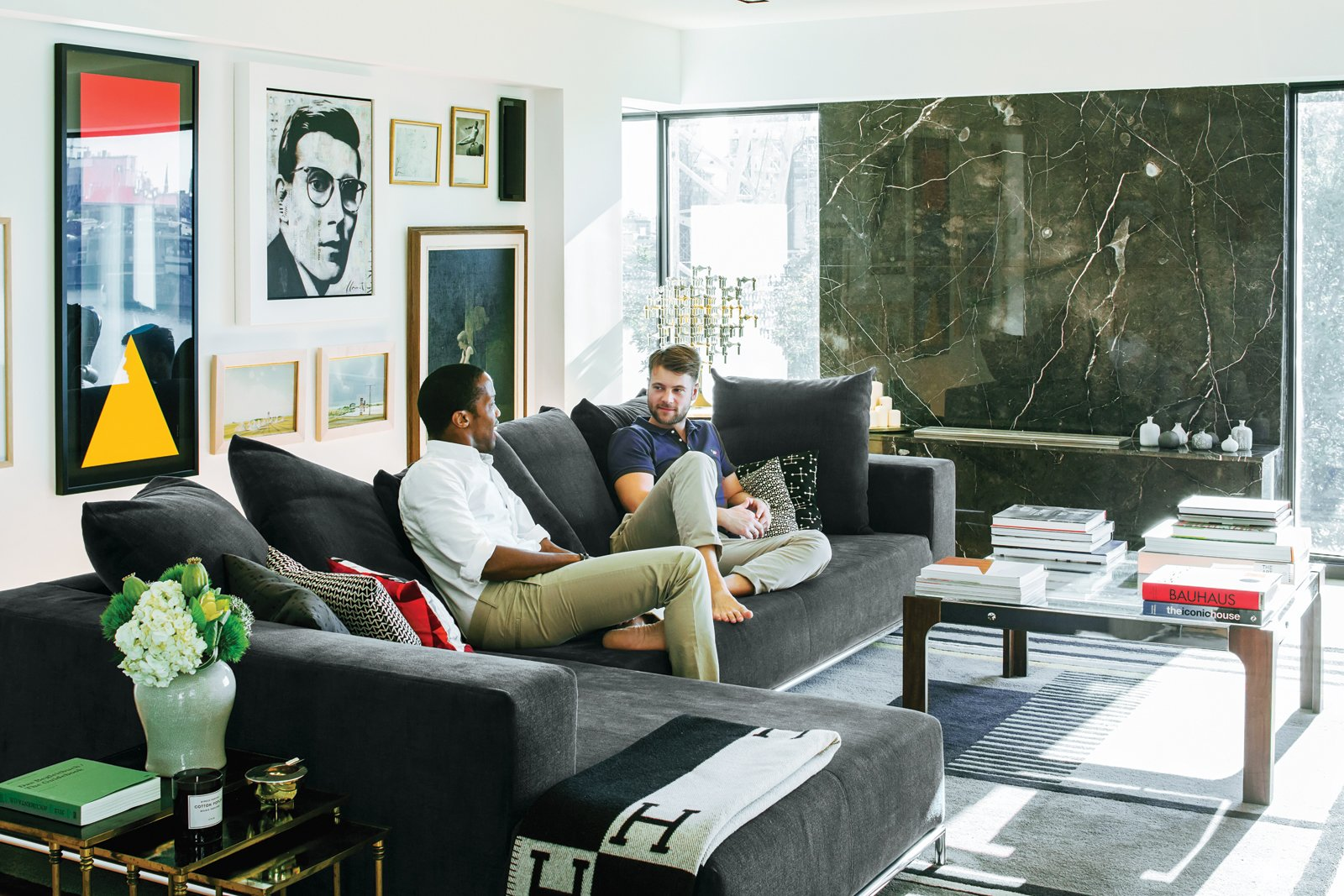In the couple's art-filled living room, a vintage coffee table sits atop a rug by Gunta Stölzl, purchased from Design Within Reach. To accommodate get-togethers with friends and family (Peart's twin brother, Dexter, lives in a neighboring unit with his wife and daughter), they sought a sofa that could hold 10 to 15 people at a time. The George sectional, designed by Antonio Citterio for B&B Italia, fit the bill. Tagged: Living Room, Coffee Tables, and Sectional. A Renovated Flat in Moshe Safdie's Habitat '67 - Photo 6 of 9