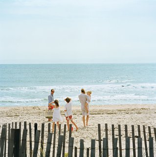 Because the ocean is so close to the house, the Fisher family treats the beach like an extended backyard.