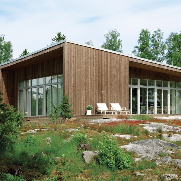 An Asymmetrical Prefab Home in Sweden  It took a mere six months—three in the factory and three on-site—for this prefab to come to fruition on the shore of Sweden's Müsko Island.