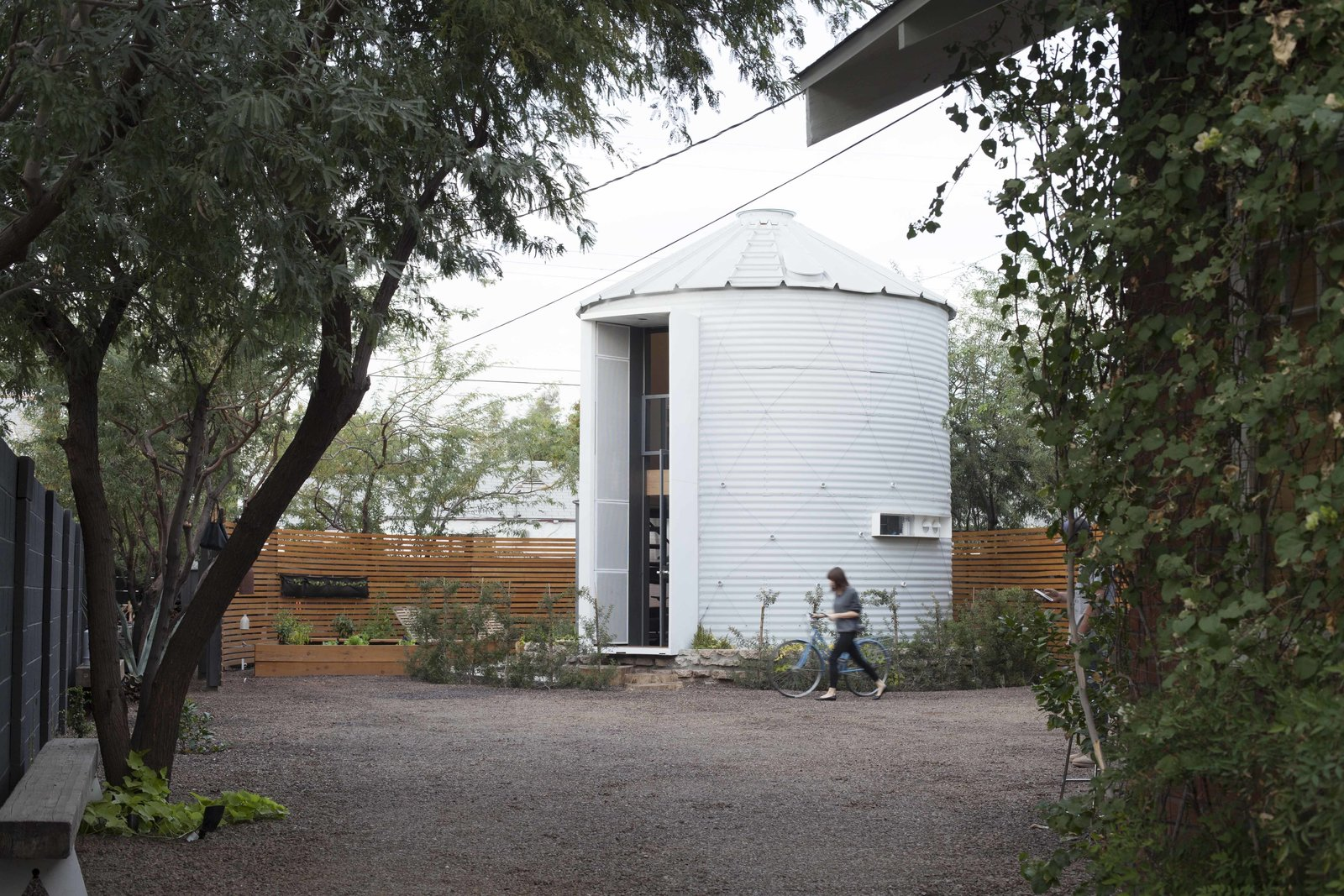The silo was transported to Phoenix in a pickup truck. Grain silos have an oculus at the top that allows air to move through the grain; Kaiser converted that into a retractable skylight.  You Won't Believe the Cozy Home Inside This Converted Grain Silo by Allie Weiss