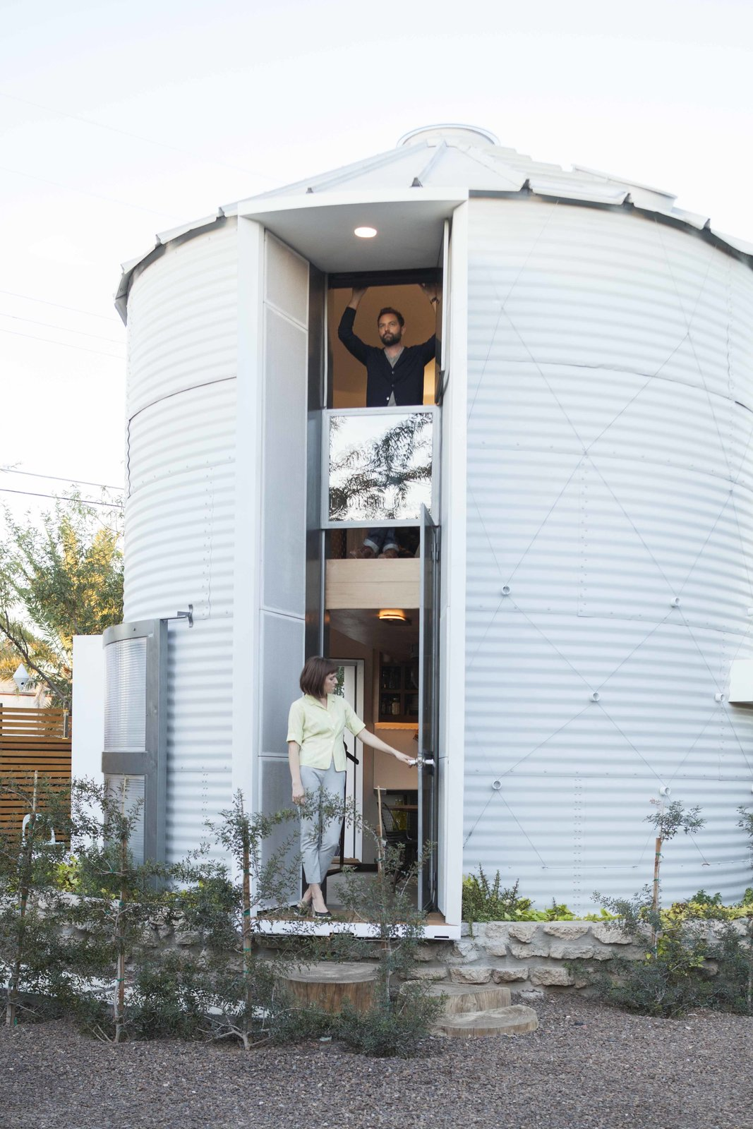 Kaiser added ten inches of spray foam insulation between the exterior shell and the interior of the house. He also fabricated all of the doors and windows in the structure.  Desert Homes by Heather Corcoran from You Won't Believe the Cozy Home Inside This Converted Grain Silo