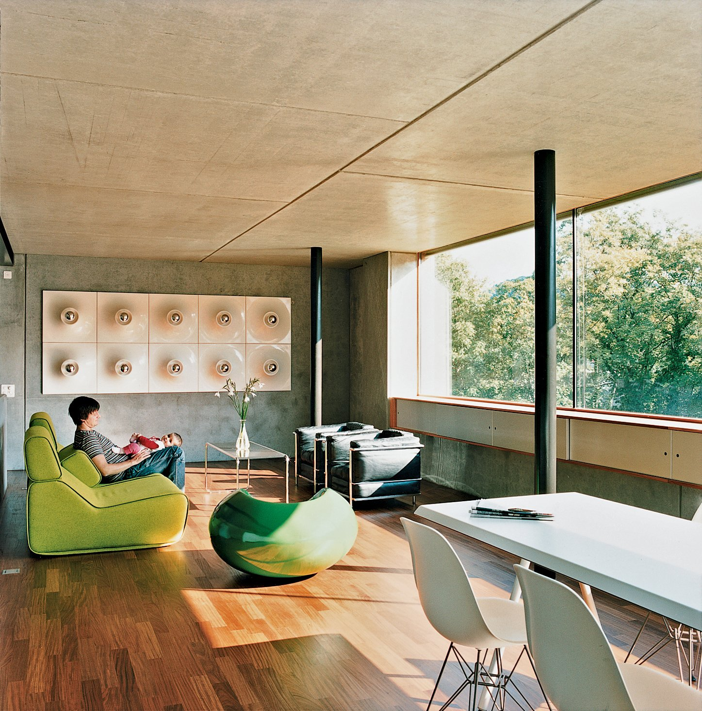 Meili and Anais lounge on a Transform sofa by Moroso. Tagged: Living Room, Sofa, Chair, Medium Hardwood Floor, and Coffee Tables.  Photo 2 of 11 in Swiss Mix