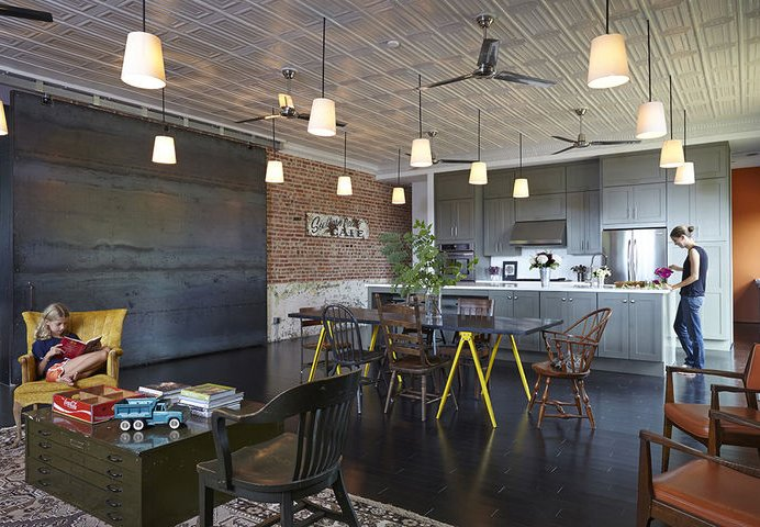 In Auburn, Alabama, architect David Hill purchased a historic brick building that had served as a Baptist church, pool hall, and barbershop. When renovating the space's interior, Hill made an effort to retain its large, open spaces, and carefully restored the original metal ceiling tiles.  20+ Modern Warehouse and Garages Conversions by Zachary Edelson from Heavenly Converted Churches