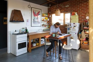 An Australian Architect's Simple Brick House With Impressive Green Roof - Photo 3 of 8 - Fuscaldo and Krien found an old workbench and used the wood to create the counter around the kitchen sink. Photo by Nic Granleese.