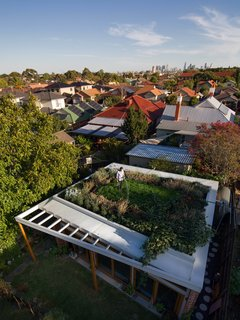 An Australian Architect's Simple Brick House With Impressive Green Roof - Photo 6 of 8 - At over 500 square feet, the house's green roof may be its most powerful—and most expensive—environmental statement. It cost $8,000 to waterproof, and $7,000 to landscape. Water from the roof feeds the toilet and the garden's watering system, and the garden itself insulates the house and keeps gas bills low in winter. Photo by Nic Granleese.