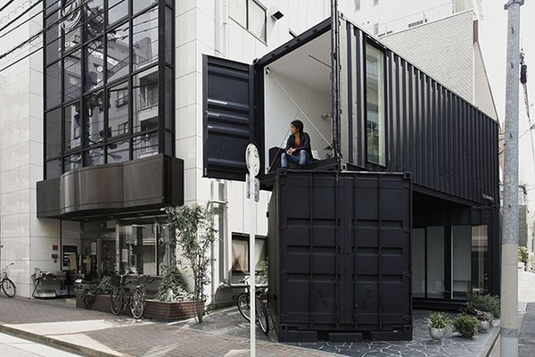 CC4441 (Tokyo, Japan)  Tomokazu Hayakawa sliced and stacked two black containers to create an angular art gallery and office space in the Taito district.  Photo by Kuniaki Sasage