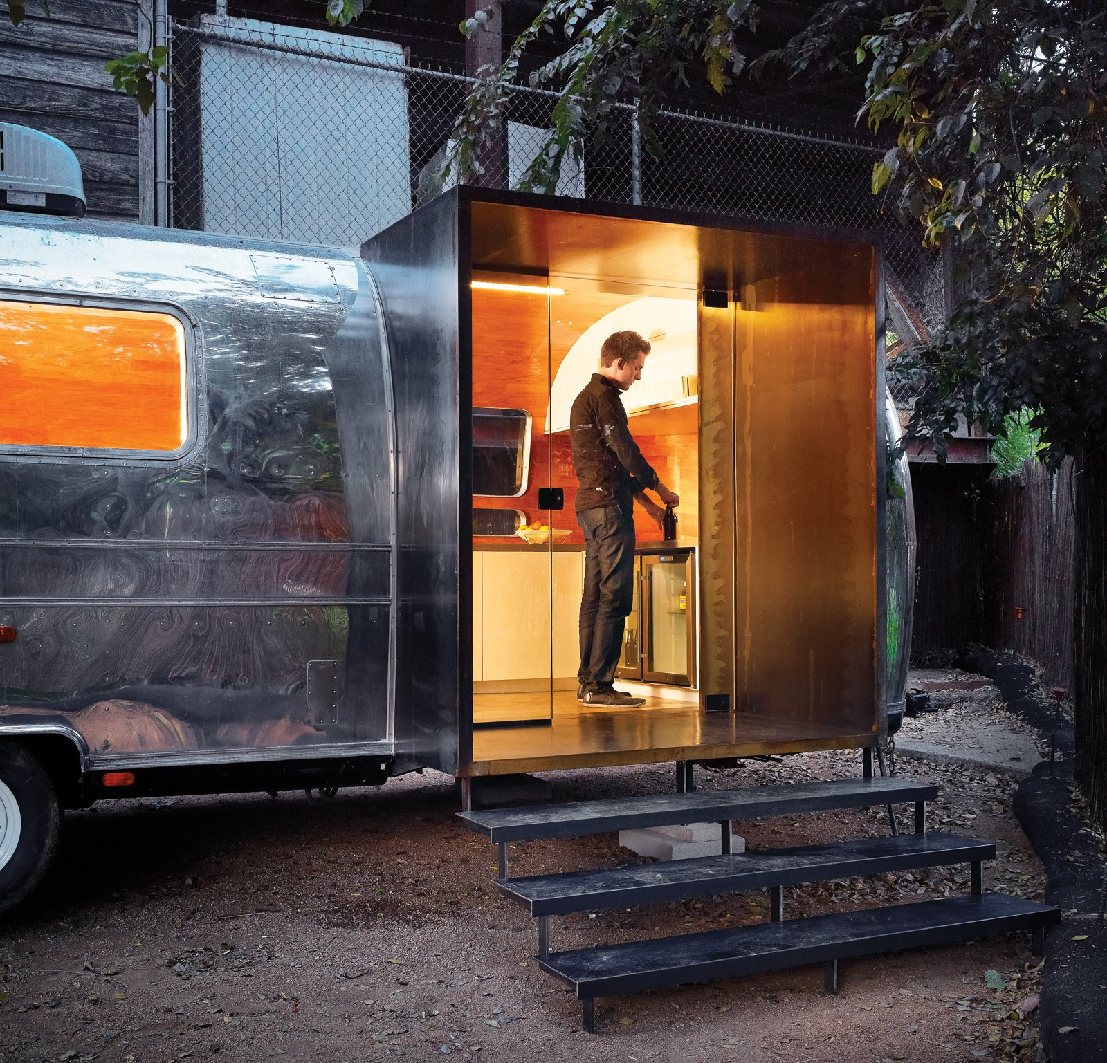 With a last minute deadline, architect Burton Baldridge transformed a decaying trailer into a modern green home for Stubb's, an Austin, Texas club. Baldridge teamed up with Branson Fustes of Pilgrim Building Company to work on the interiors and building custom furniture, such as a bar on one end. Tagged: Exterior and Airstream Building Type.  Photo 7 of 10 in 10 Tiny Trailers to Take on an Adventure from Trailer Flash