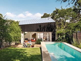 1920s Bungalow Plus Modern Addition Equals Perfect Austin Home - Photo 2 of 11 - Shah, Suttles, and their daughter, Tesla, use their outdoor space as an extra room. Near the pool is a seating area with Bistro chairs from Fermob.