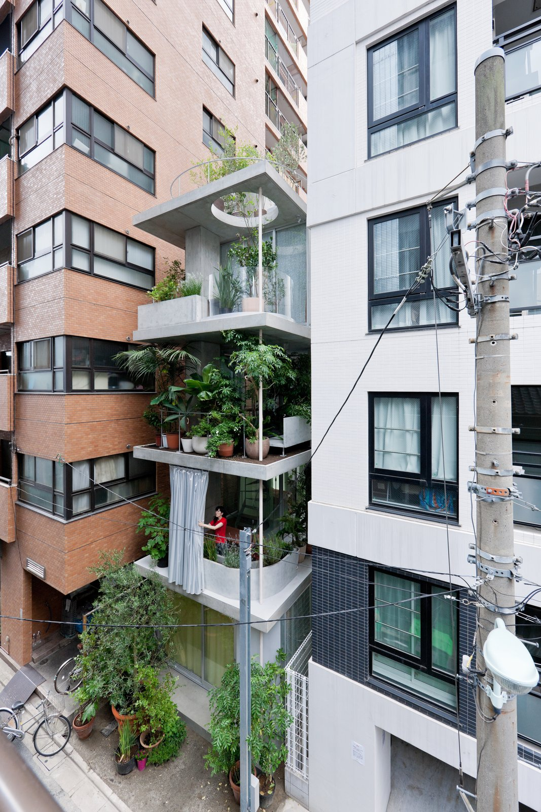 A series of open, street-facing gardens make up this five-story, 700-square-foot home in Tokyo, Japan. Called Garden & House, it was designed by Ryue Nishizawa, and serves as part of a study of new urban lifestyles for the non-nuclear family.  Japanese Homes by Dwell from These Contemporary Homes Defy Convention