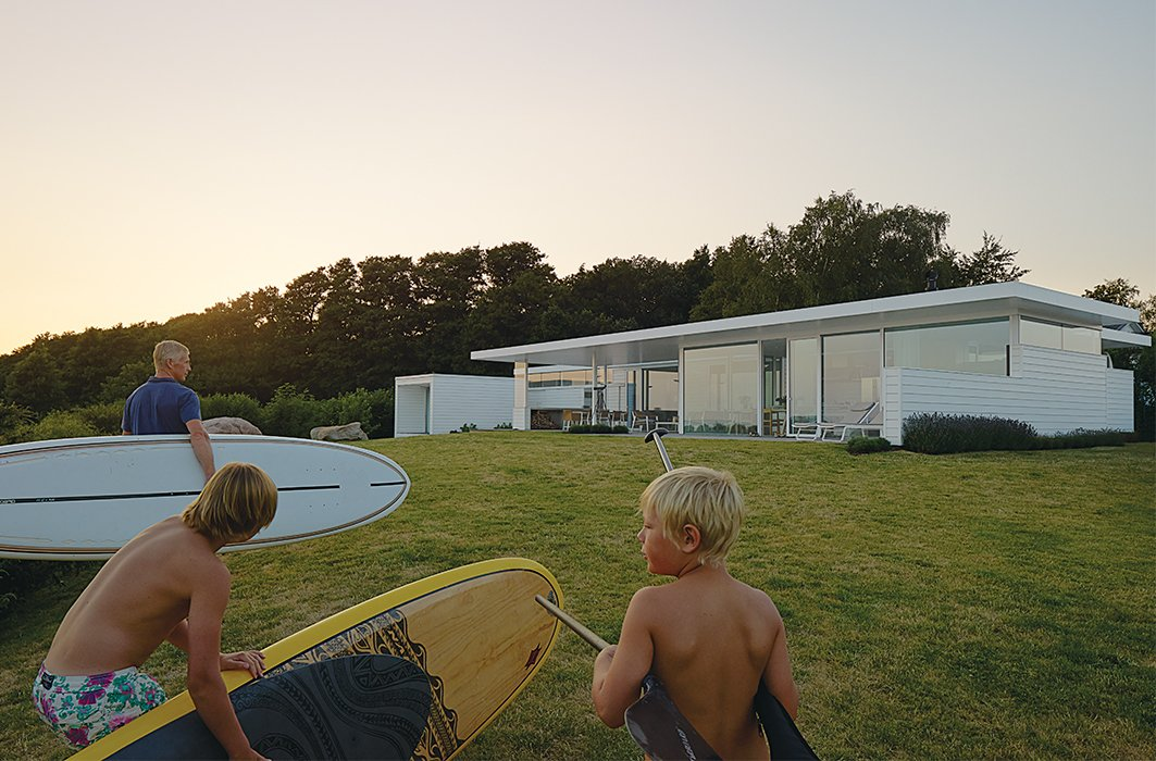 """""""We really love it here and we will never sell it, so this is a real once-in-a-lifetime place,"""" says Henrik. """"We always dreamed of building a house in this style.""""  Photo 9 of 10 in A Scandinavian Summer Home Built for Surf, Sports, and Sun"""