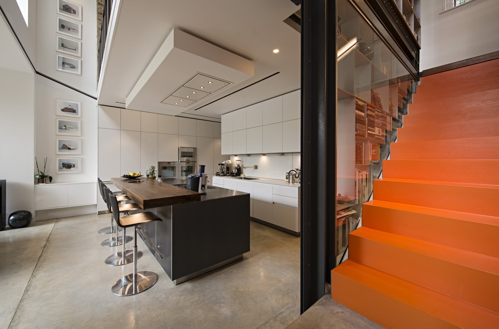 The stairs roll out into the kitchen and dining areas. The individual steps are steel trays dipped in orange liquid rubber, to squeaky effect. 190+ Best Modern Staircase Ideas by Dwell