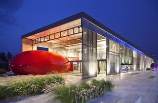 I Love Modern Architecture - Photo 8 of 20 - The building wraps around a red core—the auditorium—covered in glass fiber.