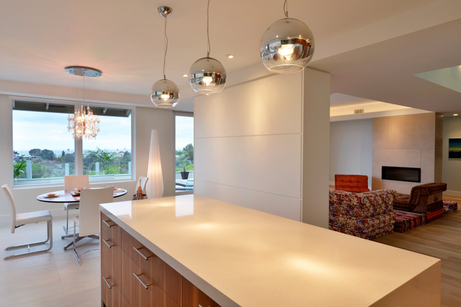 The 1Light pendants above the kitchen island are from Eurofase.