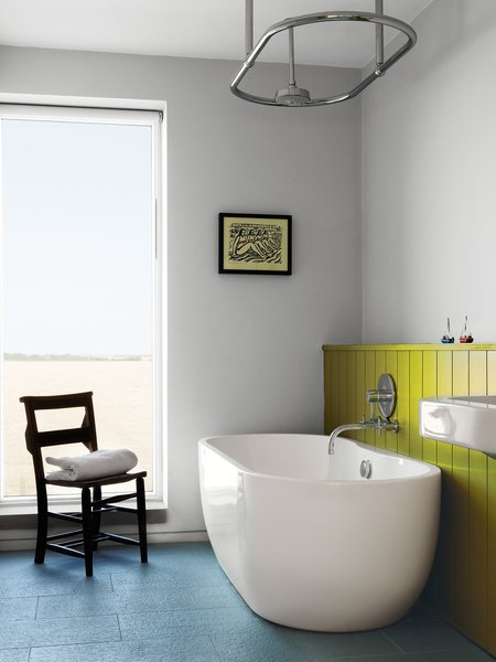 "A Lisbon freestanding tub and ""a church chair from a junk shop"" complete the children's bathroom."