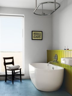 "10 Ideas For Designing With a Modern Bathtub - Photo 9 of 10 - A Lisbon freestanding tub and ""a church chair from a junk shop"" complete the children's bathroom."