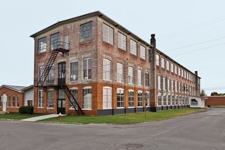A Design Duo Takes Over A Whole Factory - Photo 1 of 7 - A 19th-century New York factory houses both Brandon and Amy Phillips's apartment and the workshop for their company, Miles & May Furniture Works.