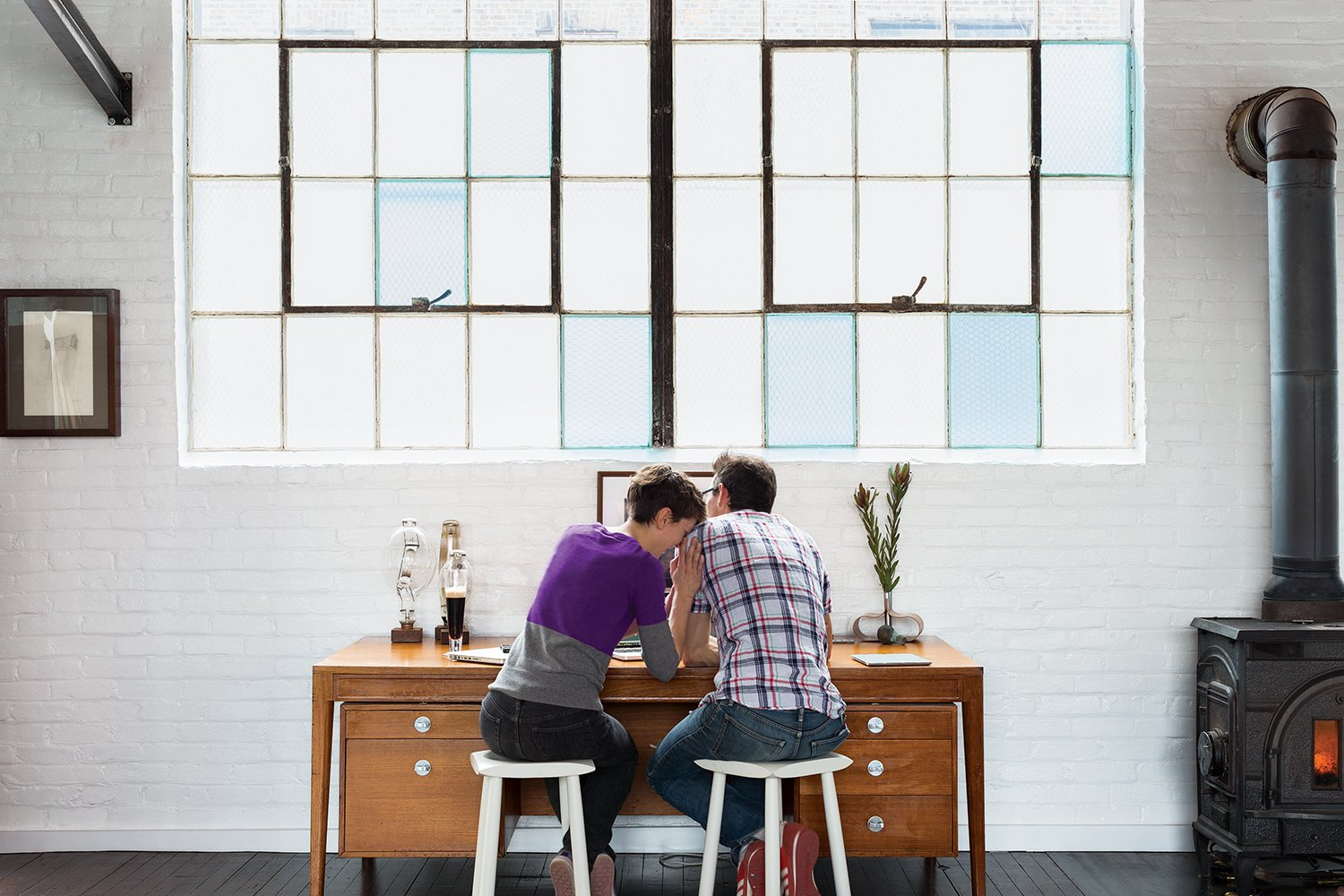 Brandon and Amy set up different workstations in the living area. Tagged: Office and Desk.  Photo 4 of 7 in A Design Duo Takes Over A Whole Factory