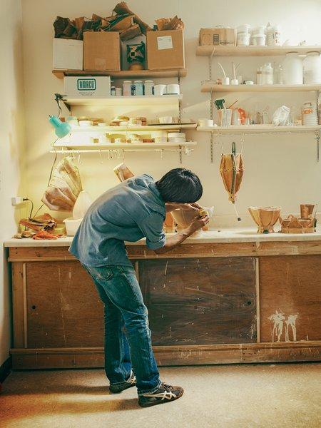Tanaka works at the ceramic station in the trio's Bushwick studio.