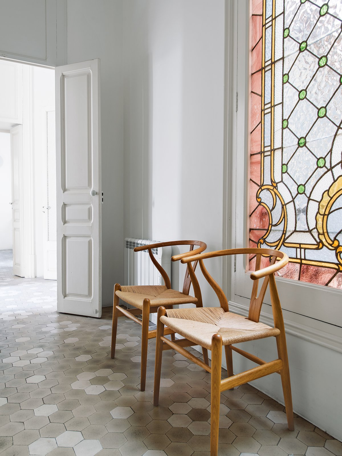 """In the hall, the designer allowed the original details to resonate. """"The old building has a lot to tell us,"""" she says.  Photo 10 of 10 in How to Save Historic Windows on an Existing Property from Love at First Sight"""
