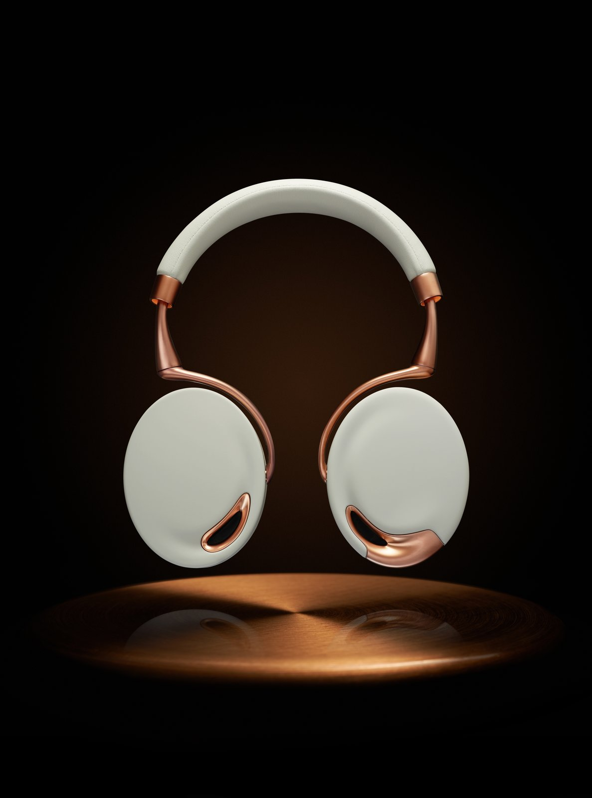 Zik Headphones -- Parrot (2012)  Audiophiles appreciate the sound quality and intuitive, motion-sensitive commands -- swipe the right earcup to increase the volume, take of the headphones and the music pauses-- built into this high-end headphones. Design fans will be equally engrossed with the generous curves and shapely form in Starck's creation. Iconic Philippe Starck Designs  by Patrick Sisson