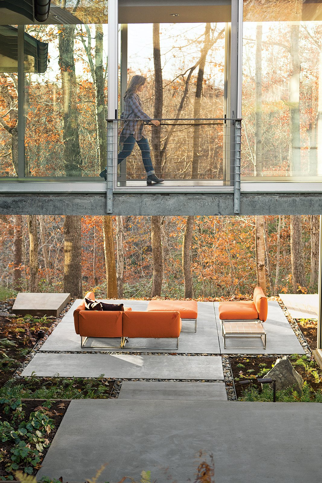 "In fall, the color of this backyard in Charlottesville, Virginia, changes daily with the foliage. Elizabeth Birdsall marvels how new outdoor spaces on her property, like a patio furnished with upholstered seating from Gloster, make enjoying the woods an easy experience: ""It's like comfortable camping, all the time."" Tagged: Outdoor, Concrete Patio, Porch, Deck, Large Patio, Porch, Deck, and Back Yard.  Photo 2 of 16 in How This Landscape Design Made a Home as Fun as a Playground"