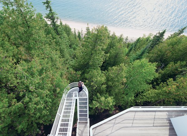 Located on the shore of Lake Michigan, the 1973 Douglas House was one of architect Richard Meier's first residential commissions. Defined by its verticality, the house features an exterior stepped walkway that extends over the trees, connecting the levels.