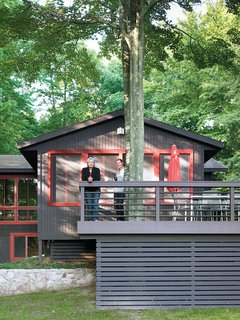 Built around the twin trunks of a maple tree, the Campbells' outdoor deck provides tranquil views of the lake and a chance for the family to spot roaming wildlife while enjoying their morning coffee. During warmer months, the wide space creates an ideal secondary dining room, shaded by the canopy of leaves overhead.