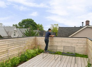 "10 Modern Rooftops For Summer Relaxing and Entertaining - Photo 10 of 10 - Two Harry Bertoia-designed chairs sit on the main third-story deck, which includes a hidden green roof that absorbs rainwater, cools the upper floors, and purifies the air. ""It's a nice little oasis on the roof, with plants that bloom at different times of year. The owners love spending time up there,"" Dubbeldam says."