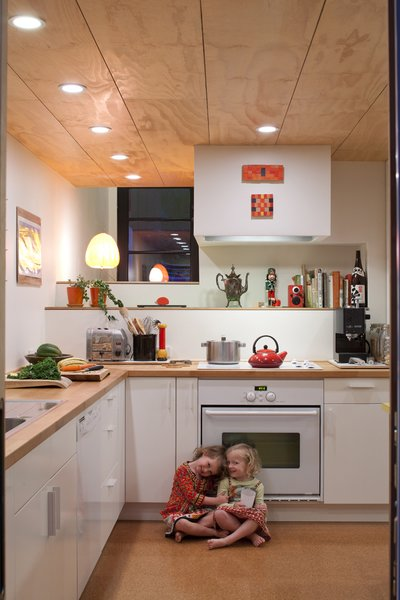 Pippa (left) and Maisie (right) play in the kitchen. Though Hale and Edmonds would have preferred Bosch appliances, a deal at Ikea was too good to pass up. They purchased all of the cabinets and appliances (a combination that earned them 20-percent off the total) for a mere $4,700.