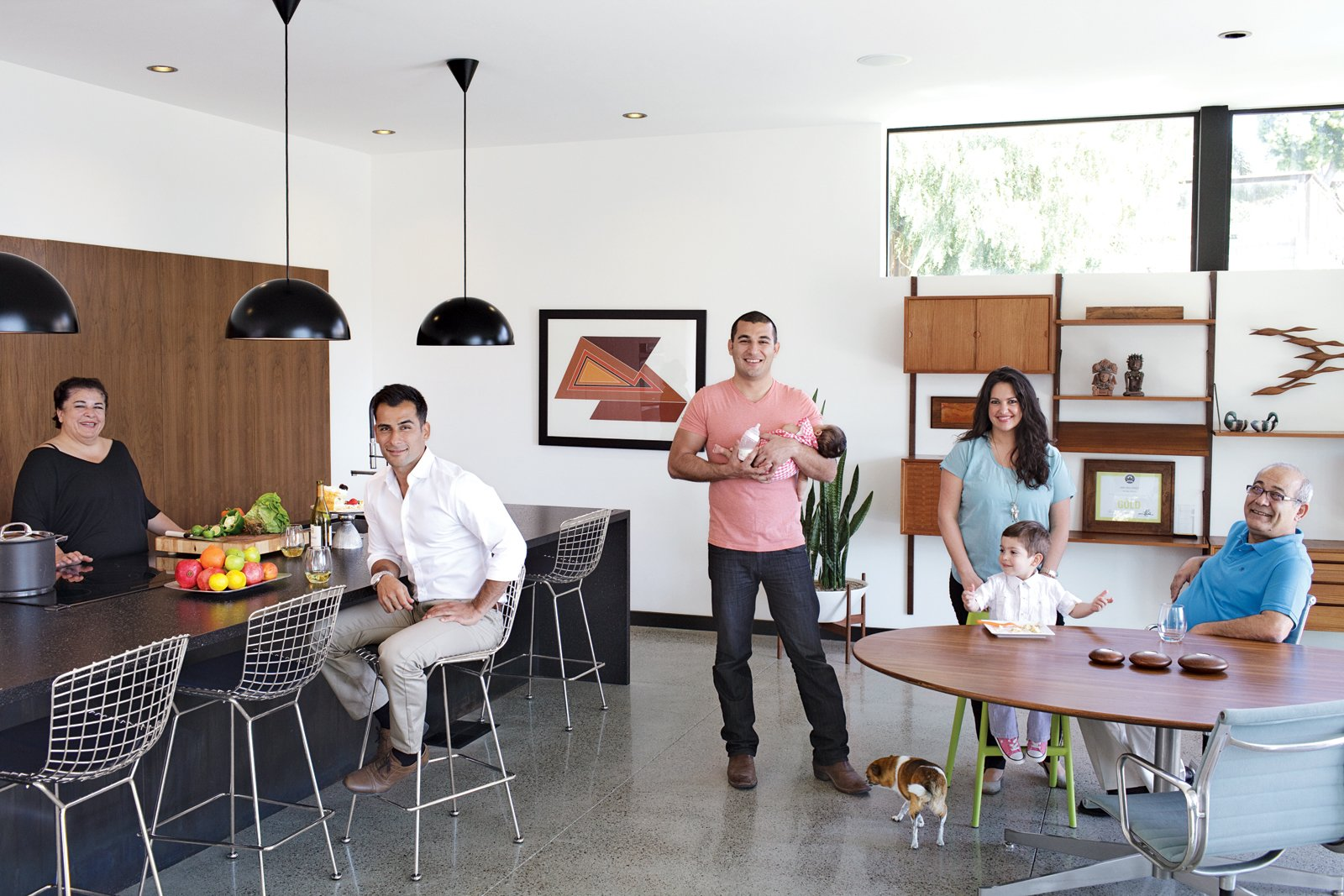 Parents Mitra and Sasan Nakhshab join sons Nima and Soheil (with daughter, Sofia) and Soheil's girlfriend, Susana Mora (with son, Shayan), on the main floor. Midcentury Homes by Dwell