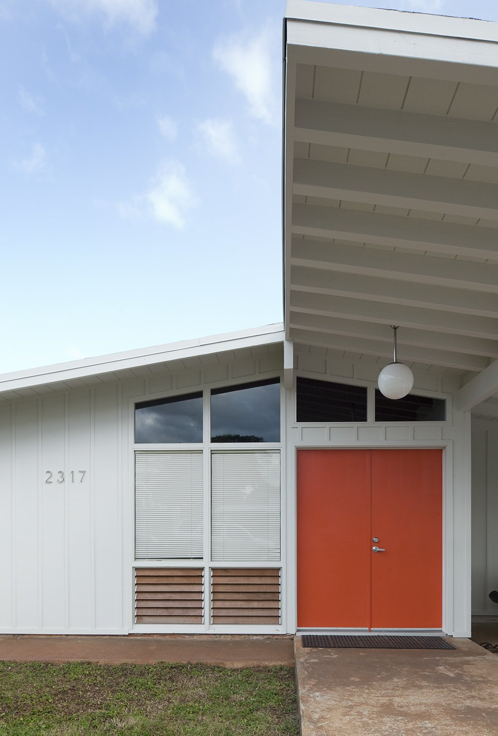 """Fritz explains, """"The primary inspiration was Dutch International Style design. The clients have roots in Holland and it started out looking more De Stijl than it does now, but ultimately, they wanted something that drew as much from their present in Hawaii as their past in Europe."""" Tagged: Exterior and Mid-Century Building Type.  Best Photos from Hillside House No. 3"""