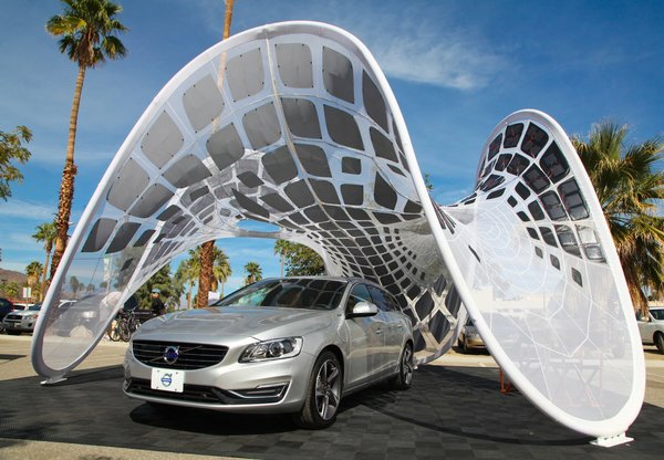 "The ""Pure Tension Pavilion"" made its U.S. debut this weekend as part of Dwell and Volvo's activation at the Modern Living Expo and Prefab Showcase. Designed by Alvin Huang, this a free-standing tensioned membrane structure is a rapidly deployable and portable solar charging station designed to power up the Volvo V60 Plug-in Hybrid, the world's first Diesel Plug-in Hybrid."