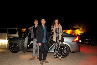 NORM designer and architect Kasper Rønn, shft.com founder Peter Glatzer, and Maria Margarita Chon exit a Volvo S60 as they arrive at the Marmol Radziner Desert Prefab for dinner.