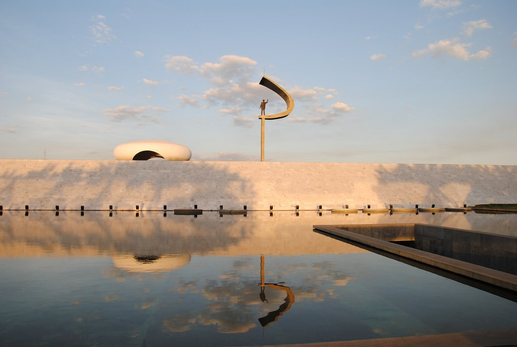 Memorial Juscelino Kubitschek  Brasilia, Brazil (1980)  The tomb of President Juscelino Kubitschek provide the late leader with a fitting resting place in the modern city that he helped create. A statue of the founder rests atop a large, question-mark shaped sculpture. Photo by Leandro Neumann Ciuffo.  Photo 7 of 10 in Design Icon: Oscar Niemeyer