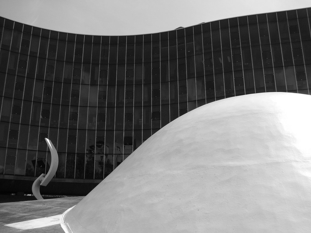Communist Party Headquarters  Paris, France (1972)  Built during Niemeyer's exile from Brazil for no charge—that's a committed member of the Party, for you—this standout structure in a Paris filled with stylish grandeur makes powerful statements with modest touches, such as the wavy glass facade, domed cupola and textured concrete walls. Photo by Lauren Manning.