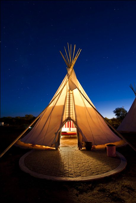 Here, one of El Cosmico's three teepees is a lantern for desert travelers.  Photo 1 of 9 in Hotels We Love: El Cosmico Hotel in Marfa, Texas