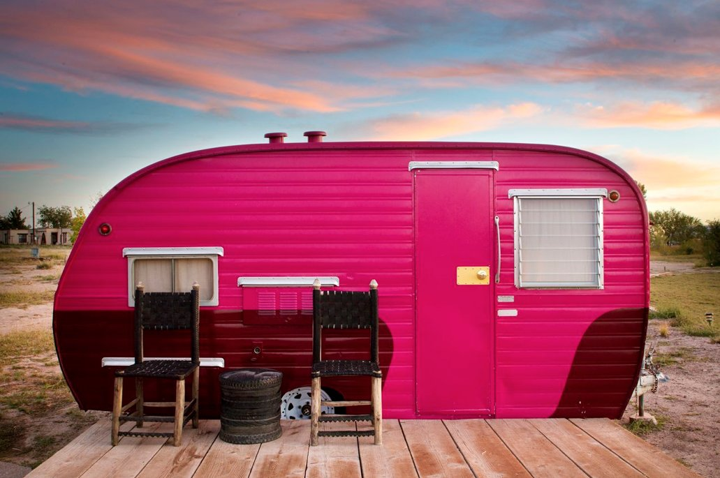 An innovative splash of color carries this trailer into compatibility with the pink clouds striating the horizon.  Photo 5 of 9 in Hotels We Love: El Cosmico Hotel in Marfa, Texas