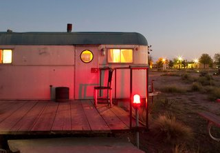 With the residents awake inside, this trailer's burnished glow reflects the sunset.