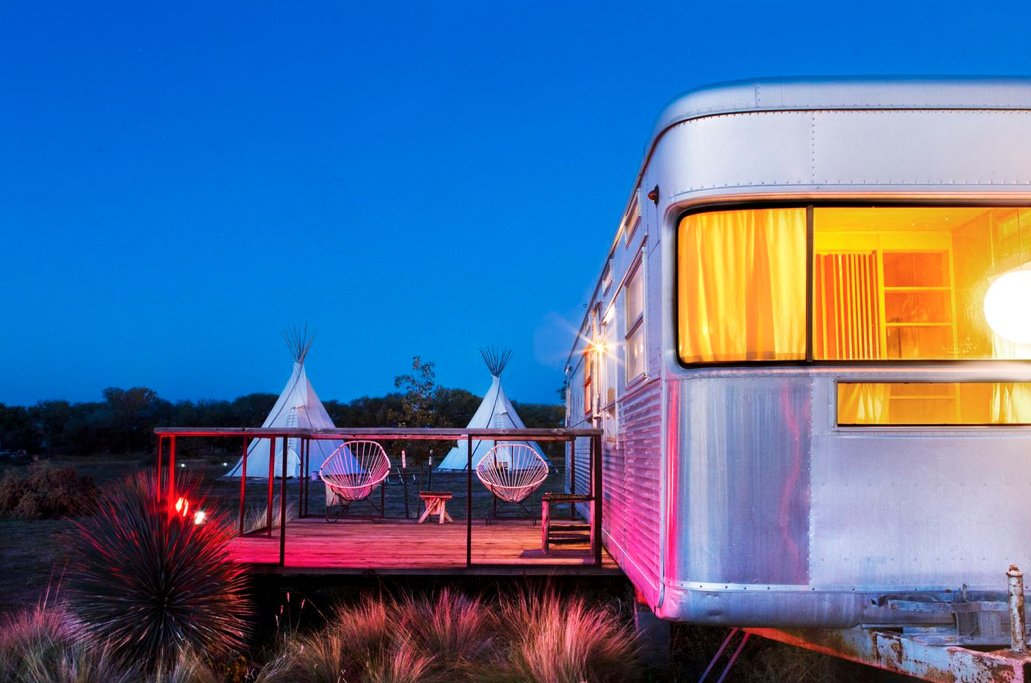Night settles in around the wanderers sheltered in El Cosmico's teepees and trailers. As El Cosmico shows, understanding a small space involves understanding the infinitude of the world beyond them.  Photo 8 of 9 in Hotels We Love: El Cosmico Hotel in Marfa, Texas