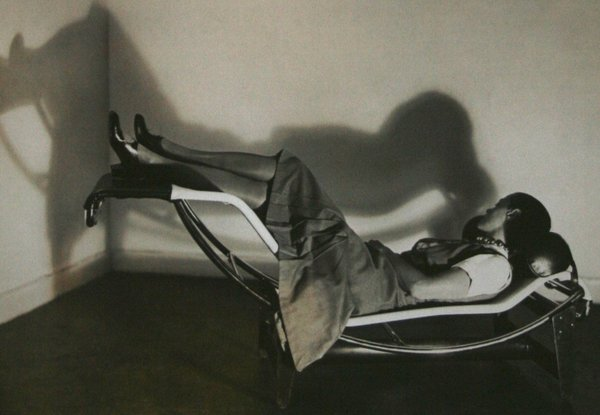 Chaise Lounge (1928)Perriand's first landmark collaboration with Corbusier and Pierre Jeanneret, this triptych of chromium-plated steel chairs, presented a Modernist view of living. Each was crafted with a specific function. The B301 sling back chair was for conversation, the LC2 Grand Confort was for relaxation, and the B306 chaise lounge was meant for sleeping. Above, Perriand, sporting a Josephine Baker hairstyle, poses with the lounge. She'd later re-interpret this signature work with bamboo. Photo via designmuseum.org.