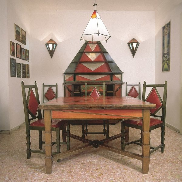 The Cimino Home Dining Room Set (Sala da pranzo di casa Cimino) by Gerardo Dottori from the early 1930s.Table, chairs, buffet, lamp, and sideboard; wood, glass, crystal, copper with chrome plating, leather, dimensions variable. Private collection © 2014 Artists Rights Society (ARS), New York / SIAE, Rome the Peggy Guggenheim Collection, Venice Photo: Daniele Paparelli, courtesy Archivi Gerardo Dottori, Perugia, Italy